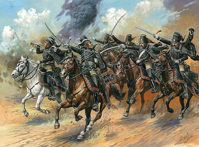 7. Fakat Hussarlar içkilerini piyadelerle paylaşmak istemez, içki fıçılarının etrafını sarıp koruma altına alır, tartışma sürerken bir asker ateş eder.