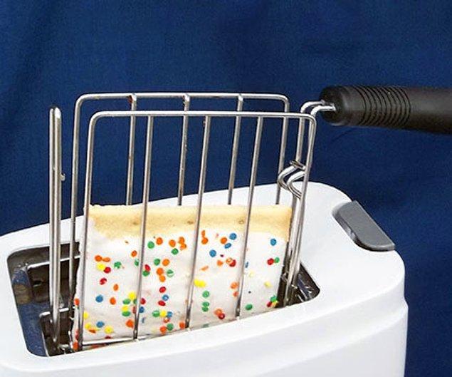 И устройство для доставания тостов к нему.