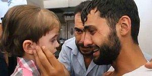 Suriye'de öldüğünü sandığı çocuğunu gören babanın mutluluk gözyaşları