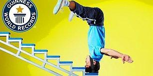 Kafasının Üzerinde Merdiven Çıkarak Guiness Rekorlar Kitabına Giren Genç