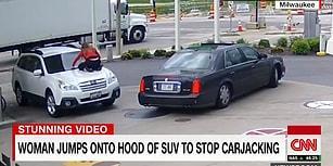 Arabasını Çalmak Üzere Olan Hırsızı Aracın Üzerine Atlayarak Engellemeye Çalışan Kadın