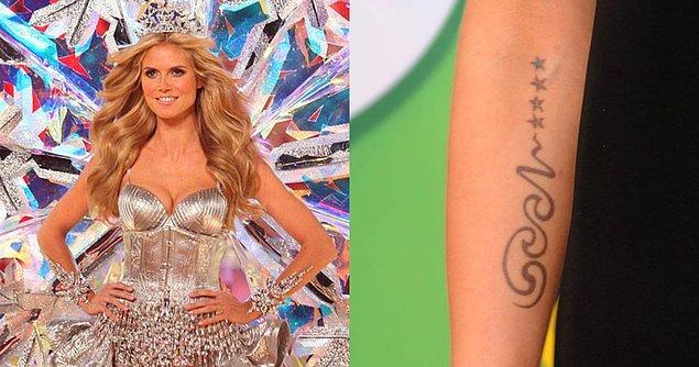 6. Heidi Klum, dövme konusunda daha cesur davranmış ve kolunun iç kısmına oldukça dikkat çekici olan bu dövmeyi yaptırmıştı.