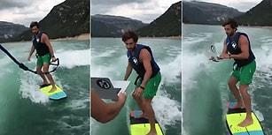 Suyun Üstünde Şov Yapmak İsterken Laptopundan Olan Adam
