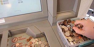 Bir Kap Dolusu Bozuk Parayı ATM'den Hesabına Yatırdı!