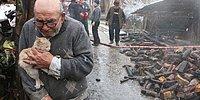 Yürek Burkan Fotoğraf: Yangında Kül Olan Evini Gözyaşları İçinde ve Kedisine Sarılarak İzleyen Ali Dede