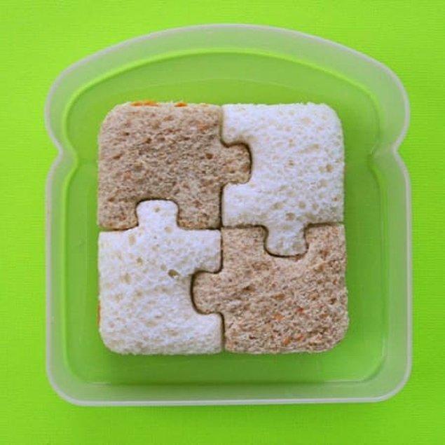 22. Sandviç yaparken biraz eğlenmek istemişler sanırım. Yap-boz şeklinde olan sandviç güzelliği diye bir şey var.