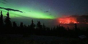 Kanada'da Yanan Ormanın Kuzey Işıkları Altında Kaydedilen Görüntüsü