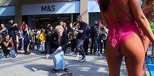 Müziğin Ritmine Kendini Kaptırarak Sokak Ortasında Kurtlarını Döken Yaşlı Kadın