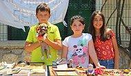 Kendileri Küçük Yürekleri Büyük: Sokakta Buldukları Yavru Köpeği Tedavi Ettirmek İçin Stant Kurup, Satış Yaptılar