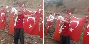 Bir Elinde Türk Bayrağı Diğer Elinde de Kuzu ile 23 Nisan Marşı Söyleyen Ufaklık