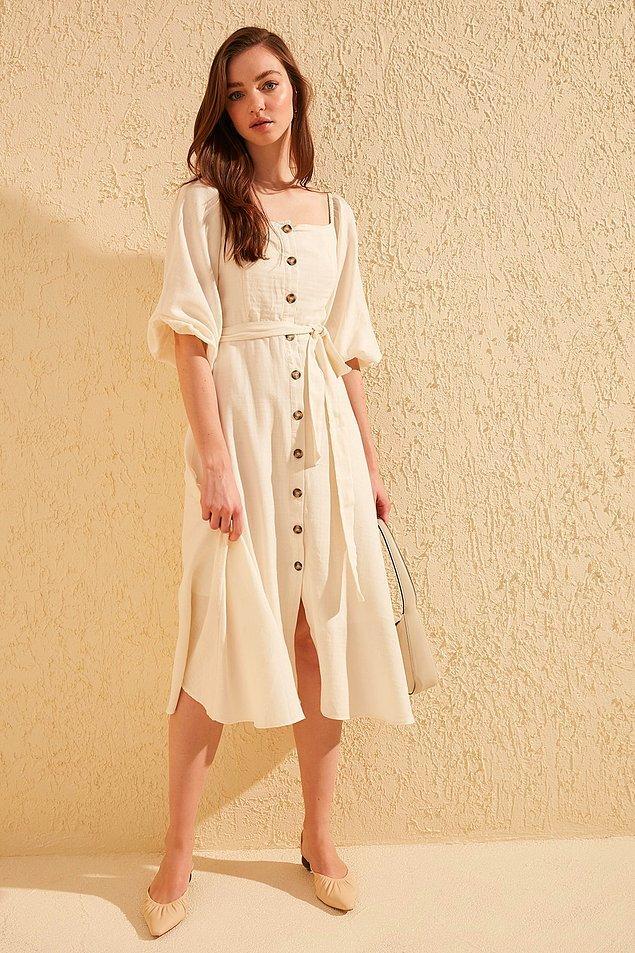 19. Şu elbisenin duruşundaki asalete bir bakın...