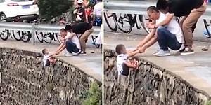 Fotoğraf Uğruna Çocuğunu Uçurumdan Sarkıtan Babanın Tepki Çeken Görüntüleri