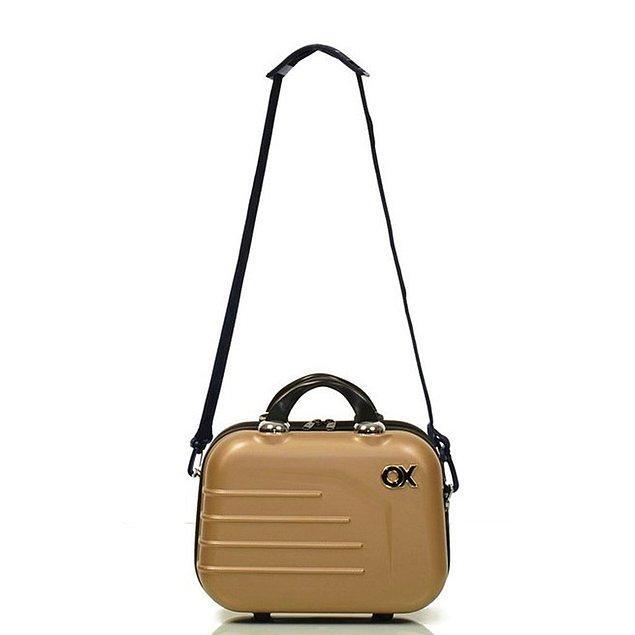 2. Valizinizin çekme koluna da takabileceğiniz son derece sağlam ve kaliteli bir bebek çantası.