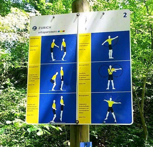 """4. """"İsviçre'de, ziyaretçilerin yürüyüşlerinde belirli noktalara ulaştıklarında uygun egzersizleri yapabilmeleri için parkların etrafında bu işaretler var."""""""